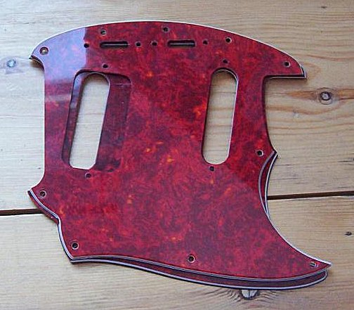 Jag-Stang pickguard on top of Mustang pickguard